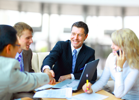 Business advisors shake hands with clients